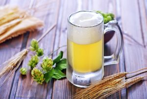 beer in glass and on the wooden table