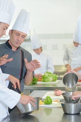 Chef explaining to trainees